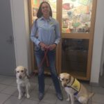 Melissa and two assistance dogs