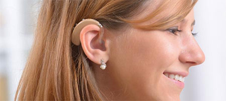 Woman wearing a hearing aid